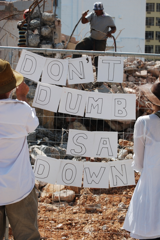 A couple post a message on a fence close to the houses of parliament in Cape Town, South Africa.